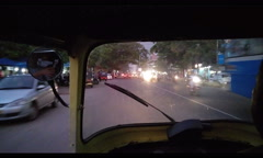 Rickshaw ride by night in India Stock Footage