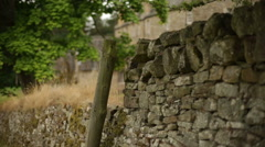 Slider shot of a rustic looking wall in Scotland Stock Footage
