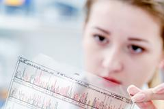 Scientific analyzes of DNA code - stock photo