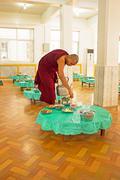 BAGO, MYANMAR -November 26, 2015: Monk serving tea in the monastery from Bago - stock photo