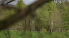 Slider shot of a fence in rural Perthshire, Scotland Stock Footage