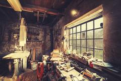 Vintage stylized old carpenter workshop interior - stock photo