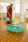 Stock Photo of BAGO, MYANMAR - November 26, 2015: Monk serving tea in the monastery from Bag