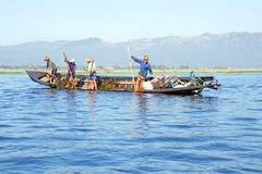 INLE LAKE, MYANMAR - NOVEMBER 23, 2015: Local workers collecting weed from th - stock photo