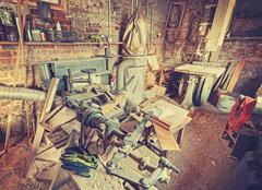 Vintage stylized old carpenter workshop interior Stock Photos