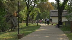 Adults and children visiting the Village Museum in Bucharest Stock Footage