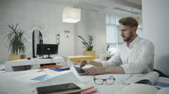 Attractive business man working at the office and looking at photo frame Stock Footage