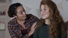4K Teenage girls in bedroom, one girl tries to comfort her sad friend - stock footage