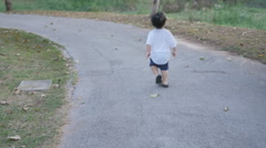 Blur little kids were running around in park, defocused video image, - stock footage