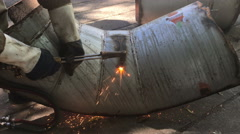 Industrial worker cutting steel duct pipe by using metal torch. - stock footage