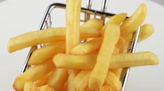 French fries in a small iron frying basket Stock Footage