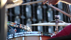 Drummer plays on the street at the concert, medium shot, outdoors Stock Footage