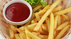 Fresh fried french fries with ketchup (loop) - stock footage