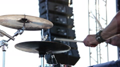 Drummer plays on the street at the concert, white background Stock Footage
