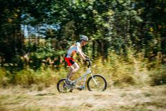 Stepper Bike cyclist riding in forest at sunny day, healthy life Stock Photos