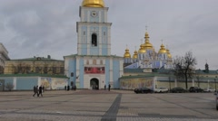 People at Tower Michael's Golden-Domed Monastery in Kiev Ukraine Church Clock - stock footage