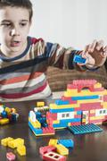 Child play with children's constructor toys - stock photo