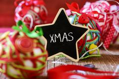 Star-shaped chalkboard with the text xmas Stock Photos