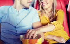 Happy couple watching movie in theater or cinema Kuvituskuvat