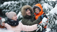 Attractive family having fun in a winter park Stock Footage