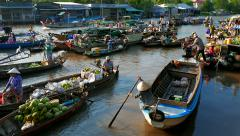 Mekong Delta floating market with vendors on boats. 4K resolution speed up Stock Footage