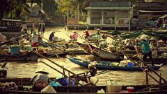 Mekong Delta floating market with vendors on boats. 4K resolution retro look Stock Footage