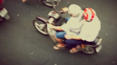 Ho Chi Minh City - Close up aerial street view with motorbikes passing by. 4K Stock Footage