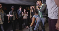Happy fun loving group of mixed race hipster friends kicking and dancing in Stock Footage