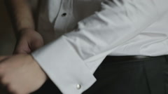 Man buttoning white shirt cuff  Stock Footage