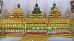 Emerald Buddha wearing three models Stock Footage