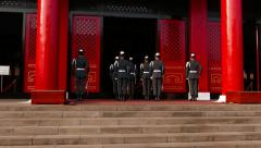 Honour guard troop stand face to Shrine entrance, loud voice sound Stock Footage