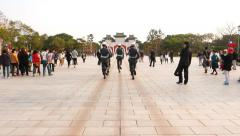 POV walk behind honour guards march across large square Stock Footage