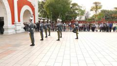 Honour guard formation begin to march out from square Stock Footage