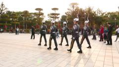 Guards troop proudly make clear steps, march across main square Stock Footage