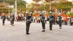 Guards salute to each other and turn, part of sentinel change ceremony Stock Footage