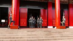 Sentinels step on pedestal, guard change at Martyr Shrine Stock Footage
