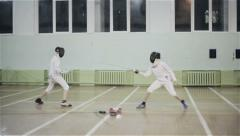Young guys fencers practicing fencing duel - stock footage
