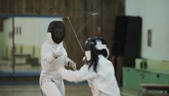 Two young women fencers on a training. Slow motion - stock footage