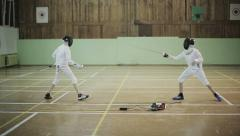 Young guys fencers practicing fencing duel. Slow motion Stock Footage