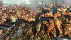 Pork and other foods roasting on the grill, Street food in Thailand. Stock Footage