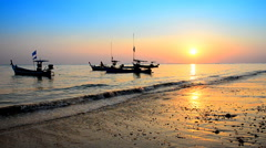Boat at beach and sunset background Stock Footage