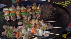 Shish kebab frying on large frying pan. Stall selling shish kebab. 1080p video. Stock Footage