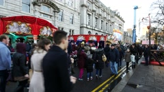 People walk on the street at Aberdeen Christmas Village festival, Scotland Stock Footage