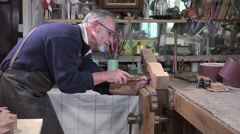 carpenter working with a chisel - stock footage