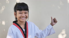 Portrait of asian children standing alone in taekwondo suit - stock footage
