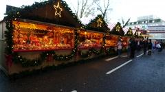 People walk on the street at Aberdeen Christmas Village festival, Scotland - stock footage