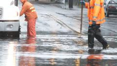 Utility Workers On Flooded Street - stock footage