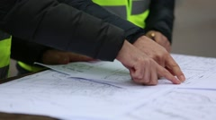 Construction personnel hands drawing on blueprints Stock Footage
