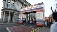 Stock Video Footage of People walk on the street at Aberdeen Christmas Village festival, Scotland