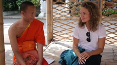 THAILAND, CHIANG MAI, 24.10.2015 - Buddhist Monk and European Girl Talking in Stock Footage